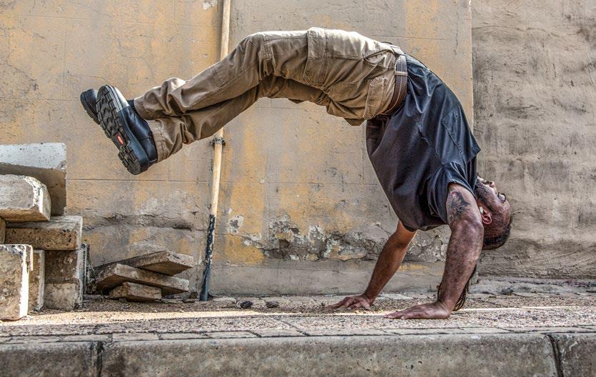 man wearing jonsson workwear doing a backflip