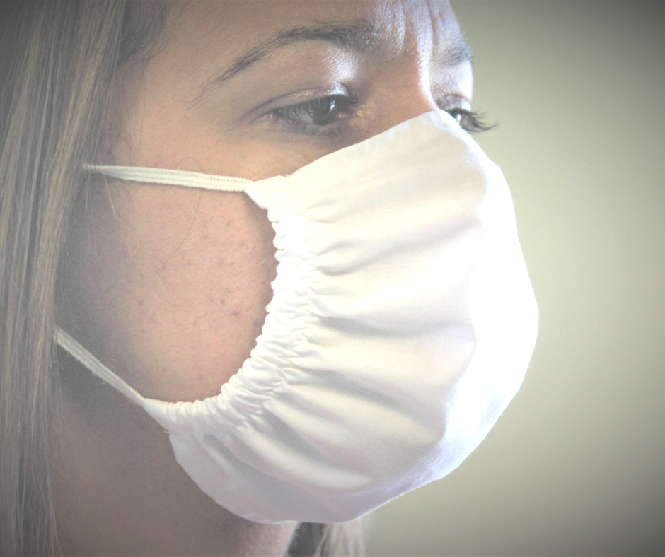 antimicrobial white face mask on a woman's face